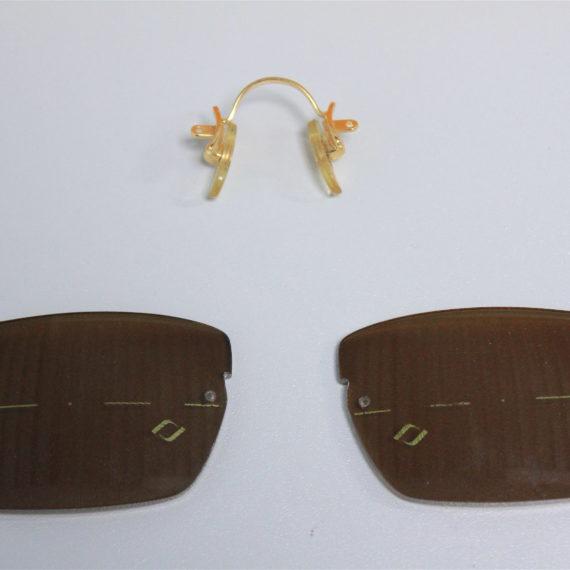 Forme rectangle sur Cartier client prévue avec verres ronds. Encoche faite à la main pour adapter le pont.