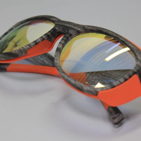 Lunettes sport Demetz équipées de verres correcteurs photochimiques miroités.