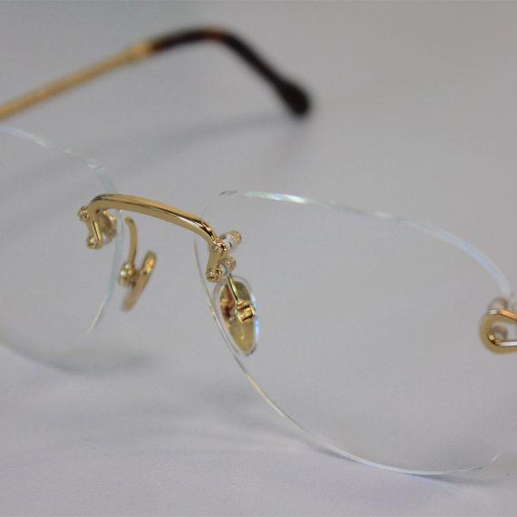 Montage de  verres percés sur lunettes FRED.